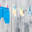 Baby clothes hanging on the clothesline. — Stock Photo #23997007