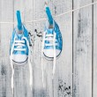 Stock Photo: Baby shoes hanging on clothesline.