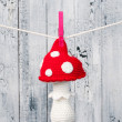 Children&#039;s toy hanging on the clothesline. - Stock Photo