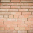 Wall of red brick. Background neat beautifully laid brick. - Stock Photo