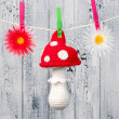 Stock Photo: Children's toy hanging on the clothesline.