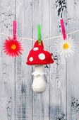 Children's toy hanging on the clothesline. — Stock Photo