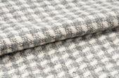 Bending woolen fabric, textile background. — Stock Photo