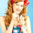 Portrait coquettish Lovely redhead pin-up girl drinks a drink fr — Stock Photo
