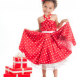Little beautiful mulatto girl with gifts. — Stock Photo
