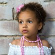 Portrait of a little girl mulatto, it is sad. — 图库照片