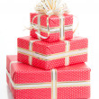 Stock Photo: Wrapped gifts with bow on white background.