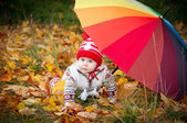 Little cute girl with colorful umbrella as a rainbow — Stock Photo