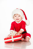 Cheerful little Santa Claus with presents. Isolated on white background. — Stock Photo