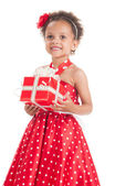 Happy little girl with a gift in mulatta hands. — Stockfoto