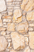 Vertical stone background wall of stonework — Stock Photo