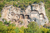 Turkish  Lycian tombs  - ancient necropolis in the mountains — Stock Photo