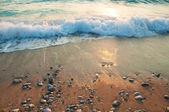 Romantic sunset at sea, waves, foam, surf — Stock Photo
