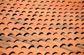 Old red tiles roof background — Stock Photo