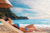 Young beautiful girl relaxing on beach — Stock Photo