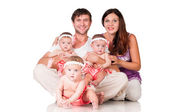 Big happy family with three daughters triplets — Stock Photo
