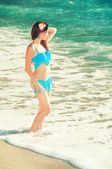 Beautiful young girl in a swimsuit at the seaside — Stock Photo