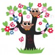 Two sweet owls sitting in a tree — Stock Vector #49746103