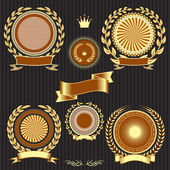 Shields, laurel wreaths and ribbons — Stock Vector
