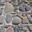 Pebbles in a stone wall — Stock Photo