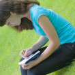 Stock Photo: Girl reads notebook