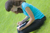 Girl reads notebook — Stock Photo