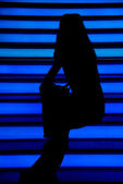Silhouette girl on the disco — Stock Photo