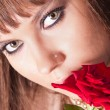 Stock Photo: Face girl or womwith red rose