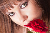Face girl or woman with red rose — Stock Photo