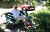 Fashion cowboy relaxing near cabriolet Corsica France — Stock Photo