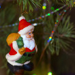 Toy Santa Claus on Christmas tree — Stock Photo