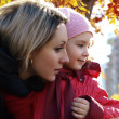 Woman with a child in the autumn of looking — Stock Photo