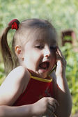 Little girl is scared and screaming — Stock Photo