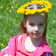 Portrait of girl with wreath of dandelions — Stock Photo