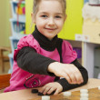 Stock Photo: Girl plays checkers