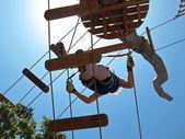 Climbing in adventure park — Stock Photo