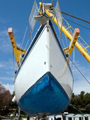 Sailboat on crane — Stock Photo