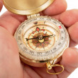 Compass in hand — Stock Photo #39688071