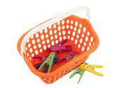 Clothes pegs and basket — Stock Photo