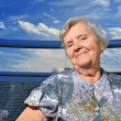 Senior woman, happy and smilling outdoors. — Stock Photo