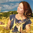 Woman in a wheat field. — Stock Photo