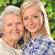 Stock Photo: Grandmother and granddaughter. Senior and young woman outdoors.