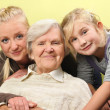 Three women - three generations. Happy and smiling. — Stock Photo