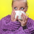 Sick woman with a flu drinking hot tea. — Stock Photo