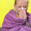 Sick woman with a flu, sneezing. - Stok fotoğraf