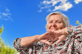 Senior woman - happy and smilling, outdoors. — Stock Photo