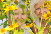 Senior woman with her mother in garden. — Stock Photo