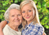 Grandmother and granddaughter. Senior and young woman outdoors. — Stock Photo