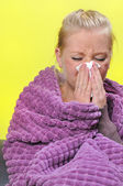 Sick woman with a flu, sneezing. — Stock Photo