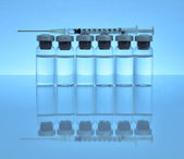 Vials of medications with syringe and needle. — Stock Photo